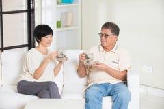 Asian senior couple having drinks Royalty Free Stock Photos