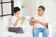 Asian senior couple having drinks Royalty Free Stock Image