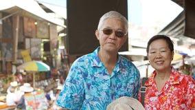 Asian senior couple having fun retirment trip around the world Stock Image