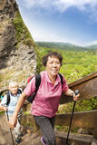 Asian senior couple hiking Stock Images