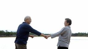 Asian senior couple holding hand Stock Photos