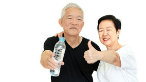 Asian Senior couple holding water bottle stay dydrate for health Royalty Free Stock Images