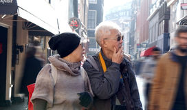 Asian senior couple lost in Europe. Travel after retirement and Royalty Free Stock Photos