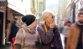Asian senior couple lost in Europe. Travel after retirement and Stock Photography