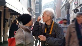 Asian senior couple lost in Europe. Travel after retirement and Royalty Free Stock Images