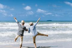 Free Asian Senior Couple Or Elderly People Walking And Siting At The Beach Royalty Free Stock Image - 157540346