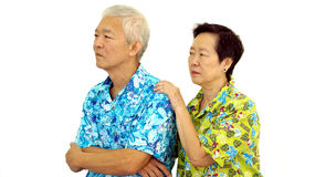 Asian senior couple pouting and try to make up after fighting Stock Images