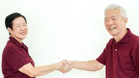 Asian senior couple promise commitment on white background. Asian senior couple promise each other on white background Stock Images