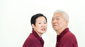 Asian senior couple promise commitment on white background. Asian senior couple promise each other on white background Royalty Free Stock Images