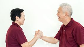Asian senior couple promise commitment on white background. Asian senior couple promise each other on white background Royalty Free Stock Photos