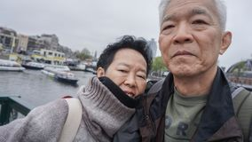 Asian senior couple selfie happy retirment trip to Europe. Asian senior couple retirment trip to Europe royalty free stock images