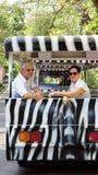 Asian senior couple riding on safari Zebra Car at zoo trail Stock Photos