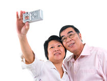 Asian senior couple self photographing Royalty Free Stock Photo