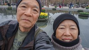 Asian senior couple selfie happy retirment trip to Europe. Asian senior couple retirment trip to Europe stock image