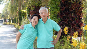 Asian senior couple smiling togher in green nature background Royalty Free Stock Images
