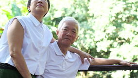 Asian senior couple stay together after retirement. hug and cuddle with love
