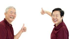 Asian senior couple thumb up white isolate background Royalty Free Stock Images