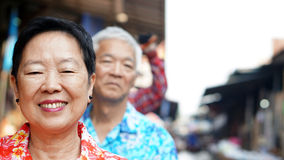 Asian senior couple travel to thailand cruising on the boat in f Stock Photo