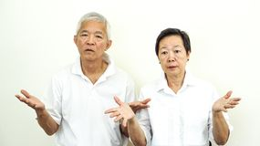 Asian senior couple unhappy angry deal with problem gesture expression stock photos
