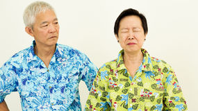 Asian senior couple unhappy, fighting. Relationship problem on w. Asian senior couple unhappy, fighting. Relationship problem Royalty Free Stock Images