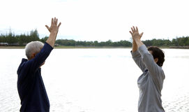 Asian Senior Elderly couple Practice Taichi, Qi Gong exercise ne Royalty Free Stock Images