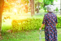 Asian senior or elderly old lady use walker with strong health while walking at park. Asian senior or elderly old lady woman use walker with strong health while royalty free stock photography