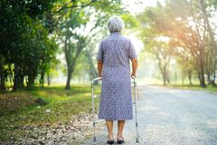 Asian senior or elderly old lady use walker with strong health while walking at park. Asian senior or elderly old lady woman use walker with strong health while royalty free stock photo