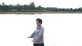 Asian Senior Elderly Practice Taichi, Qi Gong exercise outdoor n Stock Photography