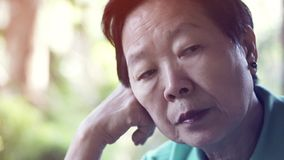 Asian senior elderly woman worry expression thinking about life royalty free stock photo