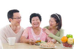 Asian senior. Female dining photo Stock Photos