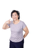 Asian senior female giving you thumbs up over white background, Royalty Free Stock Image