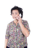 Asian senior female with  mobile phone in hand isolated on white Stock Images