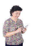 Asian senior female with  mobile phone in hand isolated on white Stock Image
