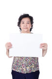 Asian senior female standing with empty horizontal blank paper i Royalty Free Stock Image