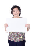 Asian senior female standing with empty horizontal blank paper i Royalty Free Stock Photo