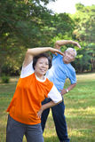 asian senior fitness couple in the park Stock Photos