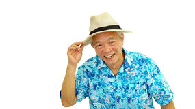 Asian senior guy on blue hawaii shirt wearing hat ready for holi Stock Photography