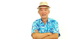 Asian senior guy on blue hawaii shirt wearing hat ready for holi Stock Images