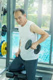 Asian senior male doing weight training Royalty Free Stock Photos
