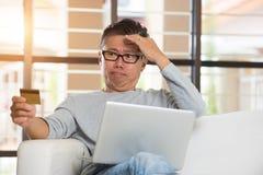 Asian senior male having trouble shopping Stock Images