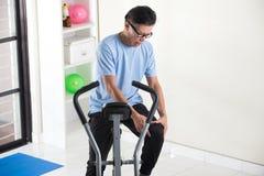 Asian senior male knee pain Royalty Free Stock Photo