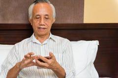 Asian senior male lifelong learning Royalty Free Stock Image