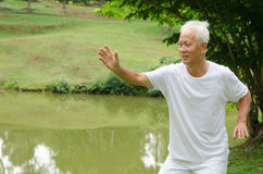 Asian senior male workout. In the park Royalty Free Stock Images
