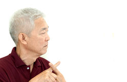 Asian senior man crossing finger say no unhappy with copy space Royalty Free Stock Photo