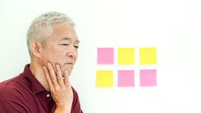 Asian senior man expression worry note paper. copy space. Asian senior man expression worry at data. copy space Royalty Free Stock Photo