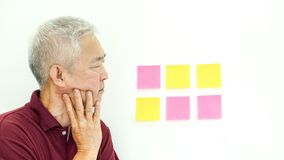 Asian senior man expression worry note paper. copy space. Asian senior man expression worry at data. copy space Stock Photo
