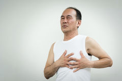 Asian senior man having heart attack. While working out on white background at the gym. copy space stock image