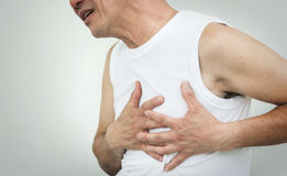 Asian senior man having heart attack while working out on white. Background at the gym. copy space Stock Image