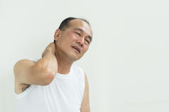 Asian senior man having pain on his shoulder and neck. copy spac Stock Photos