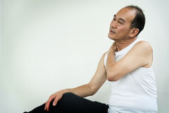 Asian senior man having pain on his shoulder and neck. copy spac Royalty Free Stock Photo